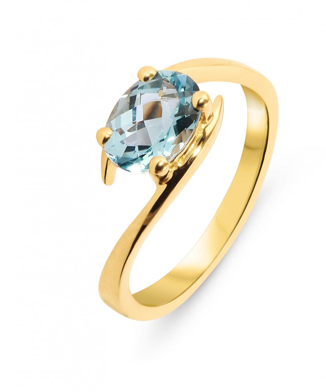 bague en or jaune avec pierre bleue