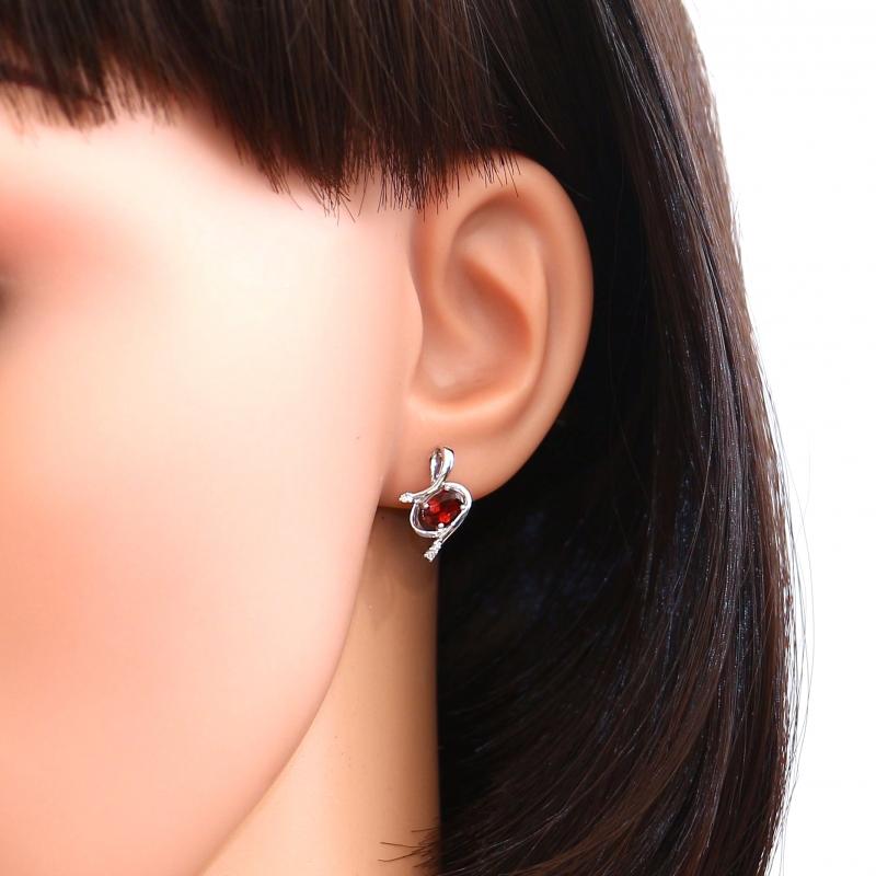 boucles d 39 oreilles or blanc 375 grenat ovale et diamant ref 39746. Black Bedroom Furniture Sets. Home Design Ideas